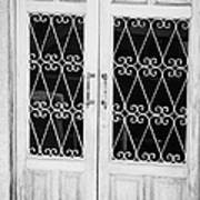 double wooden doors with wrought iron decorative window guards Tenerife Canary Islands Spain Art Print