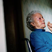 Elderly Woman Sitting In A Wheel Chair Art Print