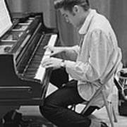 Elvis Presley on piano while waiting for a show to start 1956 Art Print