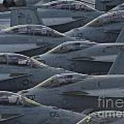 Fa18 Super Hornets Sit On The Flight Deck Of The Aircraft Carrier Uss Enterprise  Art Print by Paul Fearn