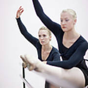 Female Ballerinas Stretching At The Art Print