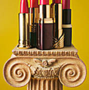 Five Red Lipstick Tubes On Pedestal Print by Garry Gay