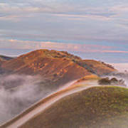 Fog Between Hills At Sunrise Art Print