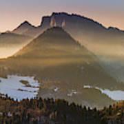 Fog Covered Mountains At Sunset Art Print
