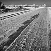 frozen salt and grit covered rural small road in Forget Saskatchewan Canada Art Print