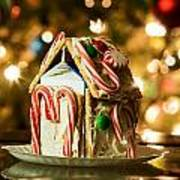 Gingerbread House Against A Background Of Christmas Tree Lights Art Print