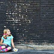 Girl Sitting On Ground Next To Brick Wall Art Print