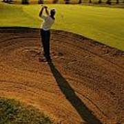 Golfer Taking A Swing From A Golf Bunker Art Print