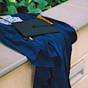 Graduation Gown With Mortarboard On Retaining Wall Art Print