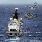 Hms Cornwall Is Pictured Receiving Stores By Merlin Helicopter  Art Print