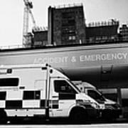 hospital accident and emergency entrance with ambulances London England UK Art Print