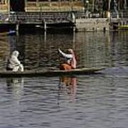 Ladies Plying A Small Boat In The Dal Lake In Srinagar - In Fron Art Print