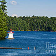 Lighthouse And Boathouse Art Print