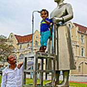 Little Girl Gets Close To Woman Sculpture In Donkin Reserve In Port Elizabeth-south Africa Art Print