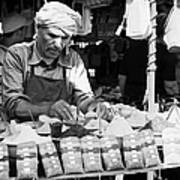 Local Arab Man Measuring Out A Quantity Of Spice For Sale On Stall Of Spices At The Market In Nabeul Tunisia Art Print by Joe Fox