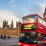 London The Uk Red Bus In Motion And Big Ben Art Print
