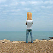 Man By The Sea With Bag On His Head Art Print