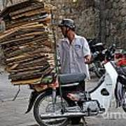 Man Carrying Cardboard On The Back Of His Scooter Art Print