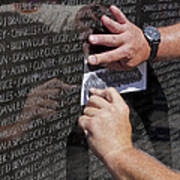 Man Getting A Rubbing Of Fallen Soldier's Name At The Vietnam War Memorial Art Print