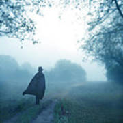Man In Top Hat And Cape On Foggy Dirt Road Art Print