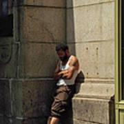 Man Leaning Against Wall In Sun Art Print