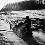 man on snowmobile crossing frozen fields in rural Forget canada Art Print