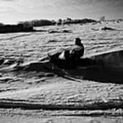 man on snowmobile crossing frozen fields in rural Forget Saskatchewan Canada Art Print by Joe Fox