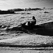 man on snowmobile crossing frozen fields in rural Forget Saskatchewan Canada Art Print