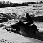man on snowmobile crossing frozen fields in rural Forget Saskatchewan Art Print by Joe Fox