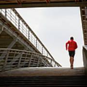 Man Running Up A Bridge Art Print