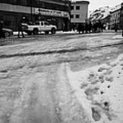 melting ice and snow on street surface holmen Honningsvag finnmark norway europe Art Print
