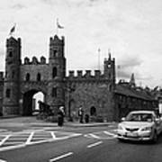 modern traffic driving past Entrance to Macroom Castle County Cork Ireland Art Print