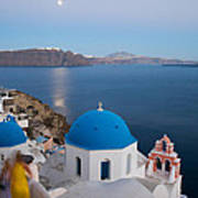 Moon Over Blue Domed Church In Oia Santorini Greece Art Print by Matteo Colombo