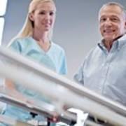 Nurse With Senior Man Using Parallel Walking Bars Art Print