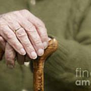 Old Hands Of A Senior On Walking Stick Art Print
