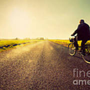 Old Man Riding A Bike To Sunny Sunset Sky Art Print