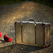 Old Suitcase With Red Shoes Left On Road Art Print by Sandra Cunningham