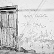 old weathered green painted wooden door entrance to abandoned house with cracked stucco walls and graffitti in Tacoronte Tenerife Canary Islands Spain Art Print