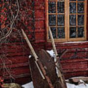 Old Wheelbarrow Leaning Against Barn In Winter Art Print
