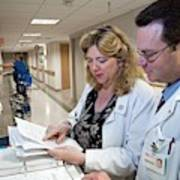 Palliative Nurse And Doctor Art Print