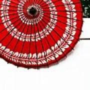 Paper Umbrella With Swirl Pattern On Fence Art Print