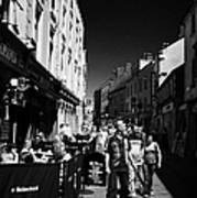 Pedestrians And Drinkers Enjoying A Sunday Afternoon Drink In The Bunch Of Grapes Pub Galway Art Print