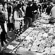 people buying chocolates on display inside the la boqueria market in Barcelona Catalonia Spain Art Print