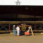 Pilot Works On Antique Plane In Hood Art Print