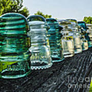 Pretty Glass Insulators All In A Row Art Print by Deborah Smolinske
