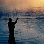 Rear View Of Fly-fisherman Silhouetted Art Print