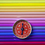 Red Compass On Rolls Of Colored Pencils Art Print