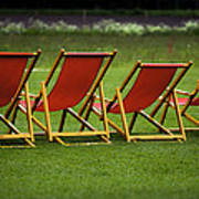 Red Deck Chairs On The Green Lawn Art Print