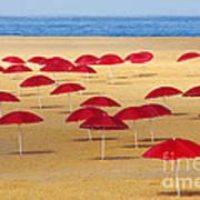 Red Umbrellas Art Print by Carlos Caetano