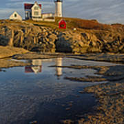 Reflecting On Nubble Lighthouse Art Print by Susan Candelario
